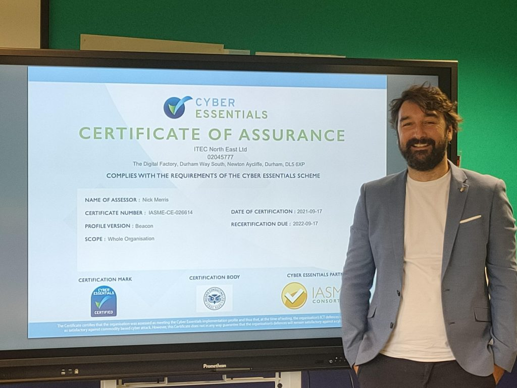 Paul Dodd posing with our Cyber Essentials Quality Mark certificate